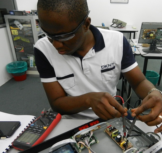 nigerian student in electronic repair course