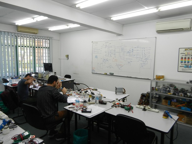 oman students learn electronics repair