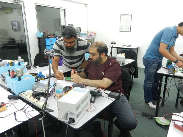 students helping each other in power supply testing