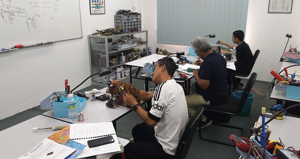 Singapore and trinidad and tobago students in electronics training repair course