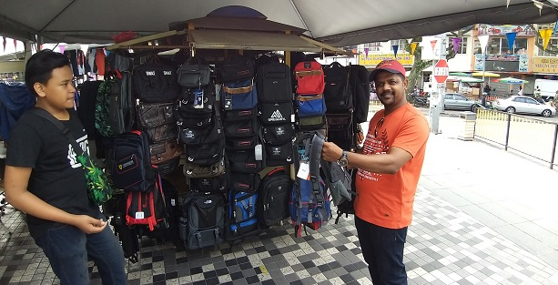 India student buy electronics and other stuff in jalan pasar malaysia
