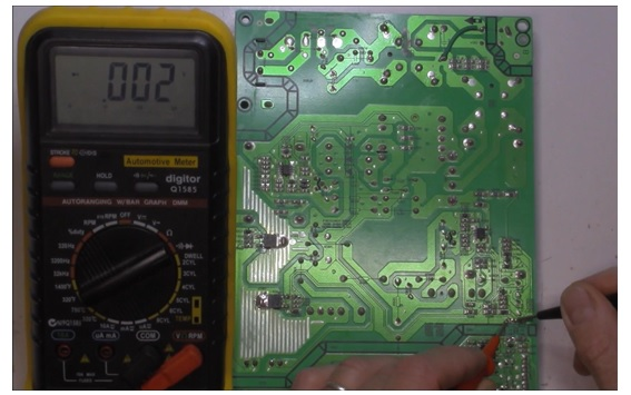 checking board with multimeter