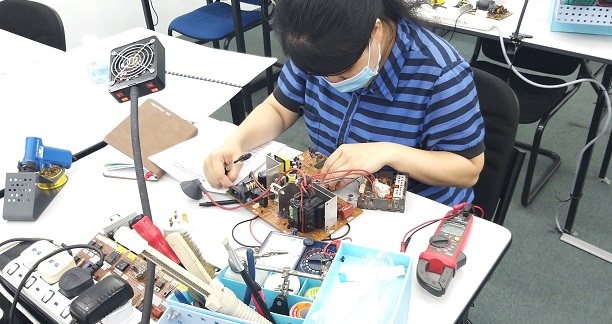 women learning electronics repair malaysia